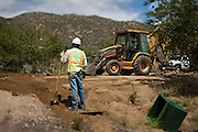 Contract construction crews at work on the Carnuel Water Systems Improvement Project on August 27, 2010. The $3.4 million project is supported by $2 million from the American Recovery and Reinvestment Act and will provide clean water to hundreds of Bernalillo County residents.