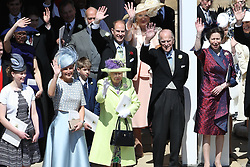 Queen Elizabeth II and other members of the royal family wave after the wedding of Prince Harry and Meghan Markle at St George's Chapel in Windsor Castle.