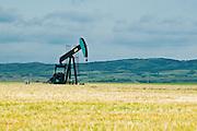 farmer's field and oil pump jack<br /> Carlyle<br /> Saskatchewan<br /> Canada