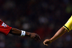 Manchester United's Eric Djemba-Djemba (l) and Charlton Athletic's Shaun Bartlett (r) go to shake hands