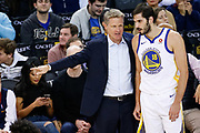 Golden State Warriors head coach Steve Kerr talks with Golden State Warriors forward Omri Casspi (18) during gameplay against the Memphis Grizzlies at Oracle Arena in Oakland, Calif., on December 20, 2017. (Stan Olszewski/Special to S.F. Examiner)