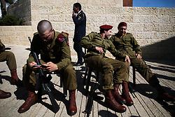 April 24, 2017 - Jerusalem, Israel - Soldiers rest before a ceremony marking the annual Holocaust Remembrance Day at the Yad Vashem Holocaust memorial, in Jerusalem, Israel, April 24, 2017. (Credit Image: © Corinna Kern/NurPhoto via ZUMA Press)