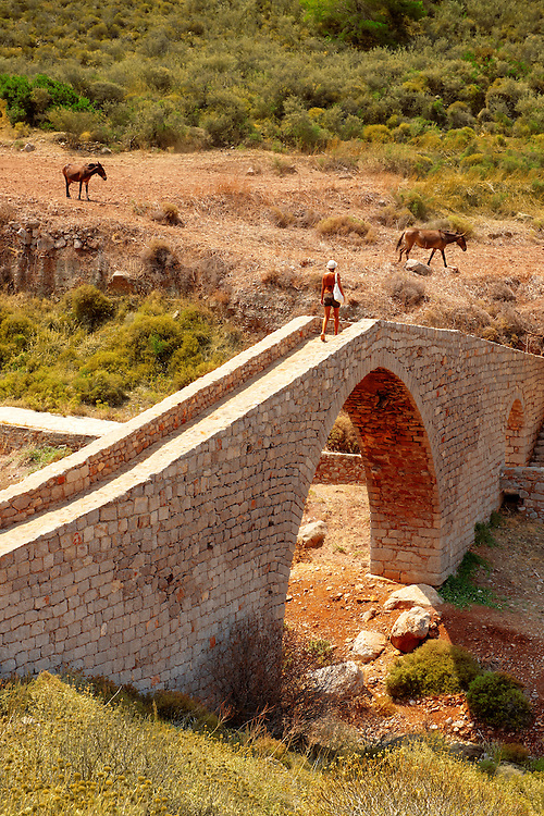 Ancient pack horse bridge at Vlychos , Hydra,  Greek Saronic Islands. .<br /> <br /> Visit our GREEK HISTORIC PLACES PHOTO COLLECTIONS for more photos to download or buy as wall art prints https://funkystock.photoshelter.com/gallery-collection/Pictures-Images-of-Greece-Photos-of-Greek-Historic-Landmark-Sites/C0000w6e8OkknEb8
