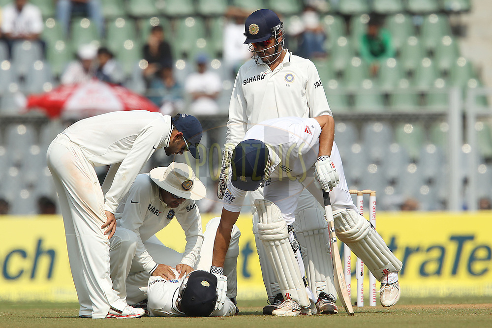 Alastair Cook - Captain of England assists Cheteshwar Pujara of India after he was hit by a shot from Cook during day 2 of the 2nd Airtel Test match between India and England held at the Wankhede Stadium in Mumbai, India on the 24th November 2012...Photo by Ron Gaunt/ BCCI/ SPORTZPICS..Use of this image is subject to the terms and conditions as outlined by the BCCI. These terms can be found by following this link:..http://www.sportzpics.co.za/image/I0000SoRagM2cIEc