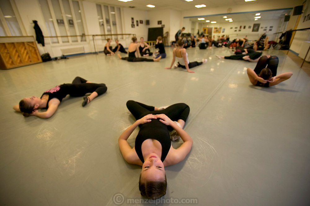 (MODEL RELEASED IMAGE). Delphine Le Moine, a dance major (center), stretches before her class at the Centre International de Danse Jazz Rick Odums. Hungry Planet: What the World Eats (p. 127).