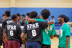 """""""The fundamentals of this is tournament is unity"""" says Newton in his speech addressing the Co-ed players representing different schools and neighborhoods.  Milton M. Newton Summer Classic Basketball Single Elimination 13-16 CoEd Tournament at the Charlotte Amalie High School Gymnasium.  St. Thomas, USVI.  8 August 2016.  © Aisha-Zakiya Boyd"""