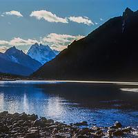 Mount Kangtega rises behind a lake in the Gokyo Valley, Khumbu region of Nepal's Himalaya.