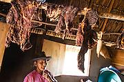 The meat is dried for storage by the indigenous woman in the Wapishana community of Katoonarib (Guyana, South Rupununi).
