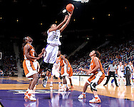 Kansas State forward Shana Wheeler (30) puts up a shot between Texas defenders Tiffany Jackson (33) and Carla Cortigo (3), during the second half at Bramlage Coliseum in Manhattan, Kansas, February 3, 2007.  Texas defeated K-State 61-34.