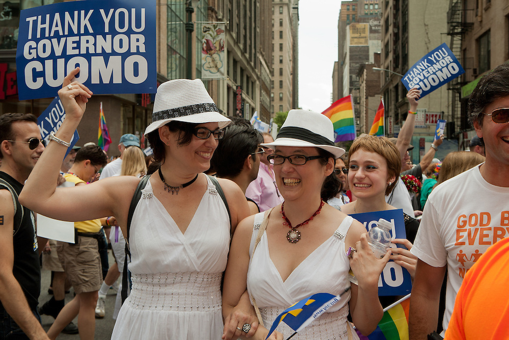 Participants in the 2011 Pride Parade on New York's fifth Avenue, with placards thanking Governor Cuomo. Cuomo was instrumental in legalizing gay marriage less that 2 days prior to the start of the parade.