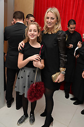 NADJA SWAROVSKI and her daughter at a pre party for the English National Ballet's Christmas performance of The Nutcracker was held at the St.Martin's Lane Hotel, St.Martin's Lane, London on 12th December 2013.