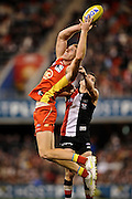GOLD COAST, AUSTRALIA - JULY 30:  Rory Thompson of the Suns maks the ball over Leigh Montagna of the Saints during the round 19 AFL match between the Gold Coast Suns and the St Kilda Saints at Metricon Stadium on July 30, 2011 in Gold Coast, Australia.  (Photo by Matt Roberts/Getty Images) *** Local Caption *** Rory Thompson