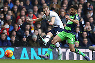 Harry Kane of Tottenham Hotspur takes a shot at goal past Neil Taylor of Swansea City. Barclays Premier league match, Tottenham Hotspur v Swansea city at White Hart Lane in London on Sunday 28th February 2016.<br /> pic by John Patrick Fletcher, Andrew Orchard sports photography.