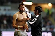 Swansea city's Michu receives treatment for blood injury.   Europa league group A match, Swansea city v FC St. Gallen at the Liberty Stadium in Swansea, South Wales on Thursday 3rd October 2013. pic by Andrew Orchard , Andrew Orchard sports photography,