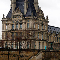 Europe, France, Paris. River View of the Louvre Museum from across the Seine.