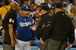 June 24, 2017 - Los Angeles, California, U.S. - Los Angeles Dodgers manager Dave Roberts talks with home plate umpire CB Bucknor (54) Fieldin Culbreth, center, and Mark Carlson, right, after a fan interference call on a double by Chase Utley (not pictured) in the sixth inning of a Major League baseball game at Dodger Stadium on Saturday, June 24, 2017 in Los Angeles. Los Angeles Dodgers won 4-0. (Photo by Keith Birmingham, Pasadena Star-News/SCNG) (Credit Image: © San Gabriel Valley Tribune via ZUMA Wire)