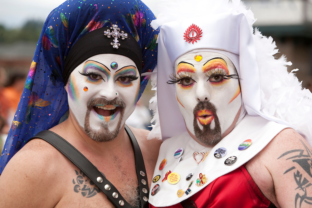 North America, United States, Washington, Seattle, men in costume at annual Summer Solstice festival in Fremont neighborhood.