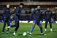 Wimbledon defender Toby Sibbick (20) and Wimbledon midfielder Liam Trotter (14) warm-up ahead of during the The FA Cup fourth round match between AFC Wimbledon and West Ham United at the Cherry Red Records Stadium, Kingston, England on 26 January 2019.
