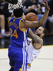 The Cleveland Cavaliers' Deron Williams, right, scores against the Golden State Warriors' Shaun Livingston in the third quarter during Game 4 of the NBA Finals at Quicken Loans Arena in Cleveland on Friday, June 9, 2017. The Cavs won, 137-116, trimming their series deficit to 3-1. (Photo by Leah Klafczynski/Akron Beacon Journal/TNS) *** Please Use Credit from Credit Field ***