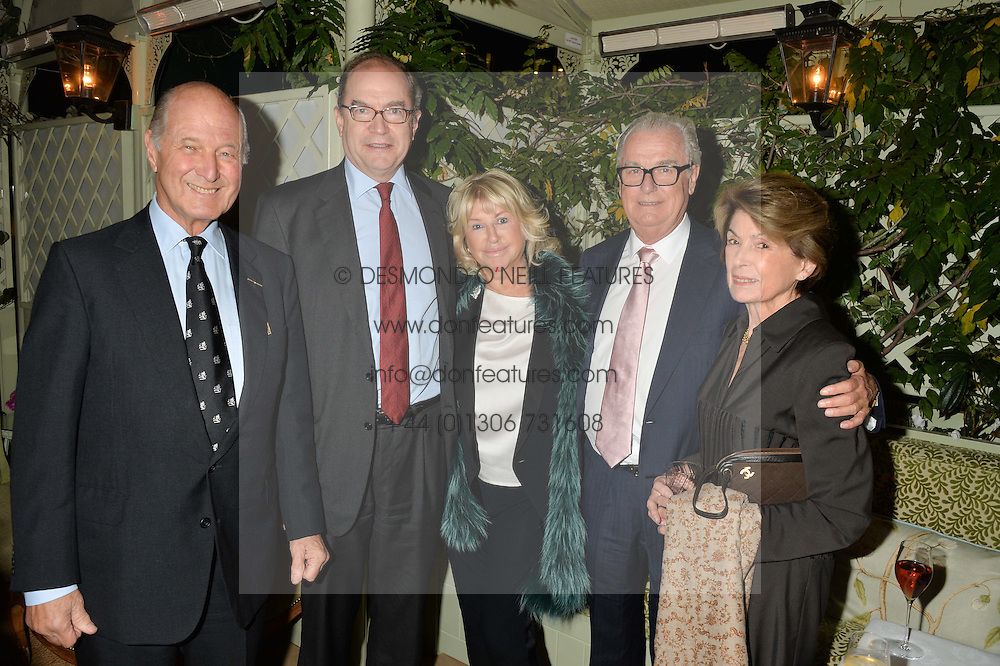 Left to right, LORD STERLING, NIGEL NEWTON (CEO, Bloomsbury Publishing), PATSY BAKER, LORD BELL and LADY STERLING at a party to celebrate the publication of Right or Wrong: The Memoirs of Lord Bell held at Mark's Club, Charles Street, London on 16th October 2014.