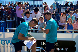 LIVERPOOL, ENGLAND - Sunday, June 24, 2018: Neal Skupski (GBR) and Ken Skupski (GBR) sign autographs for supporters during day four of the Williams BMW Liverpool International Tennis Tournament 2018 at Aigburth Cricket Club. (Pic by Paul Greenwood/Propaganda)