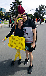 A couple costumed as wine and cheese pose for a photo at the 107th running of the Bay to Breakers, Sunday, May 20, 2018, in San Francisco. (Photo by D. Ross Cameron)