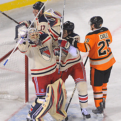 New York Rangers goalie Henrik Lundqvist (30) celebrates victory with center Brian Boyle (22) at the end of NHL Winter Classic action between the New York Rangers and Philadelphia Flyers at Citizens Bank Park. The Rangers defeated the Flyers 3-2.