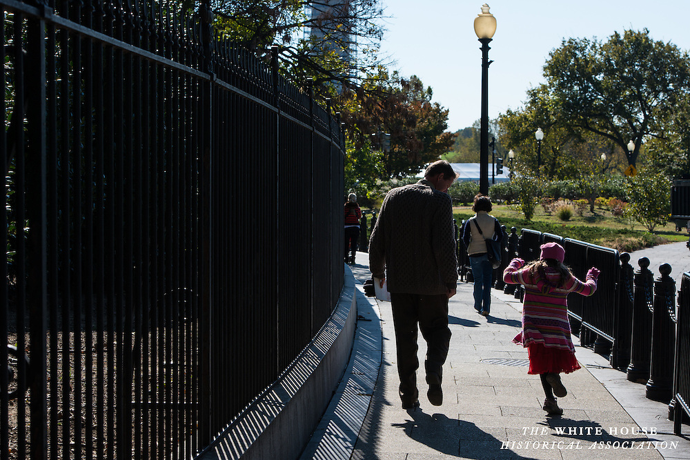 A father and daughter exit the White House garden tour, 2013.