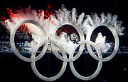 A snowboarder flies through the Olympic rings during the opening ceremony of the Vancouver Winter Olympic Games in Vancouver, British Columbia February 12, 2010. REUTERS/Jim Young