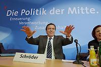 13 MAY 2002, BERLIN/GERMANY:<br /> Gerhard Schroeder, SPD, Bundeskanzler, versucht den Applaus zu daempfen, vor Beginn der SPD Parteikonferenz, links: Heidemarie Wieczorek-Zeul, Bundesentwicklungshilfeministerin, Willi-Brandt-Haus<br /> IMAGE: 20020513-03-009<br /> KEYWORDS: Gerhard Schröder, Schriftzug, Die Politik der Mitte