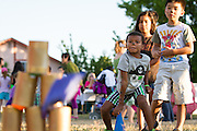 Jonas Petty (5) tosses a beanbag at stacked cans during National Night Out at Berryessa Creek Park in San Jose, Calif., on Aug. 7, 2012.  Kids of all ages enjoyed face painting, games, ice cream, and an outdoor viewing of Disney's Up.  Photo by Stan Olszewski/SOSKIphoto.