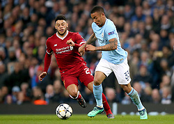 Manchester City's Gabriel Jesus (right) and Liverpool's Alex Oxlade-Chamberlain battle for the ball