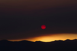 dramatic sunset due to a forest fire in New Mexico