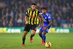 Watford's Troy Deeney (left) and Cardiff City's Leandro Bacuna battle for the ball during the Premier League match at the Cardiff City Stadium.