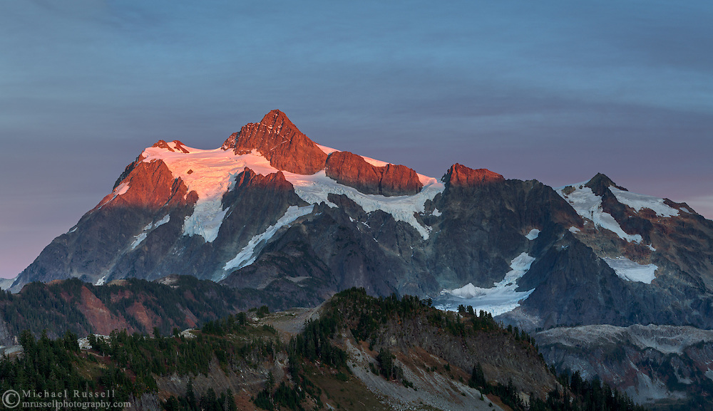Last light of sunset on Mount Shuksan above Huntoon Point on Kulshan Ridge.  Photographed in the fall from the Chain Lakes Trail in the Mount Baker Wilderness, Washington State, USA.