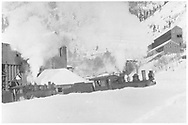 """RGS 2-8-0s #12 and #10 plowing snow on Lower Black Bear Station spur at Pandora.  The Lower Black Bear station is at left, while the Old Red Mill is at upper right.<br /> RGS  Pandora, CO  Taken by Virden, Walter<br /> In book """"Southern, The: A Narrow Gauge Odyssey"""" page 99<br /> Same as RD171-051.  For companion picture see RD155-101 and  """"RGS Story Vol. II"""", p. 285.<br /> Thanks to Don Bergman for additional information."""