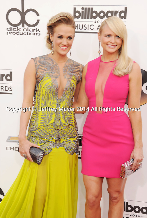 LAS VEGAS, CA- MAY 18: Singers Carrie Underwood (L) and  Miranda Lambert arrive at the 2014 Billboard Music Awards at the MGM Grand Garden Arena on May 18, 2014 in Las Vegas, Nevada.