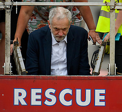 """© Licensed to London News Pictures. 27/06/2016. London, UK. Labour Party leader JEREMY CORBYN climbs down from a fire engine after addressing a """"Keep Corbyn"""" Momentum demonstration outside the Houses of Parliament in london. The majority of the Labour shadow cabinet resigned today (Mon) in protest at Corbyn's leadership. Photo credit: Ben Cawthra/LNP"""