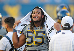 Sep 11, 2021; Morgantown, West Virginia, USA; West Virginia Mountaineers defensive lineman Dante Stills (55) smiles along the sidelines during the third quarter against the Long Island Sharks at Mountaineer Field at Milan Puskar Stadium. Mandatory Credit: Ben Queen-USA TODAY Sports