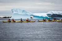 Kayakers in Antarctica exploring the icy surrounds.