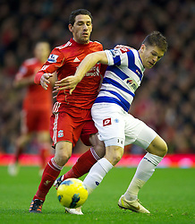 10.12.2011, Anfield Stadion, Liverpool, ENG, PL, FC Liverpool vs Queens Park Rangers, 15. Spieltag, im Bild Liverpool's Maximiliano Ruben Maxi Rodriguez in action against Queens Park Rangers's Jamie Mackie during the Premiership match at Anfield the football match of English premier league, 15th round, between FC Liverpool and Queens Park Rangers at Anfield Stadium, Liverpool, United Kingdom on 2011/12/10. EXPA Pictures © 2011, PhotoCredit: EXPA/ Propagandaphoto/ David Rawcliff..***** ATTENTION - OUT OF ENG, GBR, UK *****