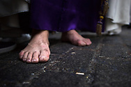 Walking the full distance of a procession, barefoot, is a deeper sign of devotion and penance. Seville, Spain
