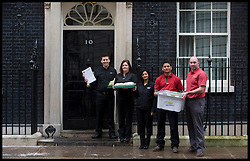 L to R David Cameron, Maureen Hibbens, Rachana Pancholi, Jitin Dixit,Harvey Brown Subway Franchisees deliver a petition to Downing Street from Subway, Tuesday January 22, 2013. Photo: Andrew Parsons / i-Images