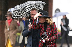 Former Scottish football player and sports pundit Alan McInally (left) during Gold Cup Day of the 2019 Cheltenham Festival at Cheltenham Racecourse.