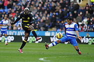Wigan's Arouna Kone (l) blasts a shot over the crossbar as he goes for a hat trick. Barclays Premier league, Reading v Wigan Athletic at the Madejski Stadium in Reading on Saturday 23rd Feb 2013. pic by Andrew Orchard, Andrew Orchard sports photography,