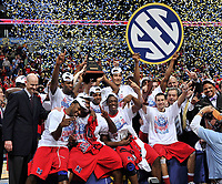 NASHVILLE, TN - MARCH 17:  The Ole Miss Rebels mens's basketball team celebrate a victory over the Florida Gators in the SEC Baskebtall Tournament Championship Game at Bridgestone Arena on March 17, 2013 in Nashville, Tennessee.  (Photo by Frederick Breedon/Getty Images)