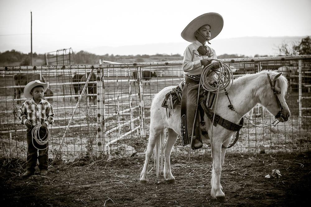 Antonio Flores, 7, prepares to ride in a charreada at Lienzo San Miguel in Atascosa, Texas.