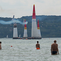 People watch as chancefull prospect Martin Sonka of Czech Republic hits a pylon and looses his chance to win the final of the Red Bull Air Race held over lake Balaton in Zamardi, Hungary on July 14, 2019. ATTILA VOLGYI