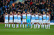 Burnley players observe a minutes silence ahead of the game. Premier League match, Burnley v Crystal Palace at Turf Moor in Burnley , Lancs on Saturday 5th November 2016.<br /> pic by Chris Stading, Andrew Orchard sports photography.