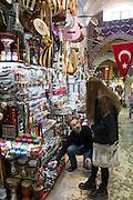 Young woman tourist shopping in The Grand Bazaar, Kapalicarsi, great market in Beyazi, Istanbul, Republic of Turkey